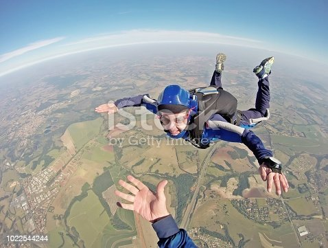 istock Happy parachutist smiling in freefall 1022544244