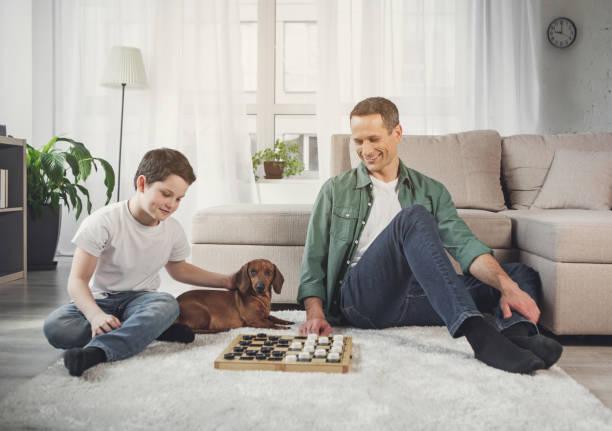 Happy parent and boy looking at chessboard with joy picture id1138361663?b=1&k=6&m=1138361663&s=612x612&w=0&h=rrp6bzsow0wo75f9yki4nyyi4tmtzb4nlgmj8uciel4=
