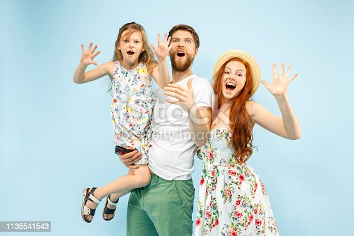 istock Happy parent with daughter at studio isolated on blue background 1135541543