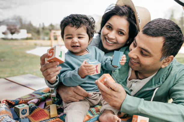 Happy parenting Smiling baby and happy parents indian family stock pictures, royalty-free photos & images