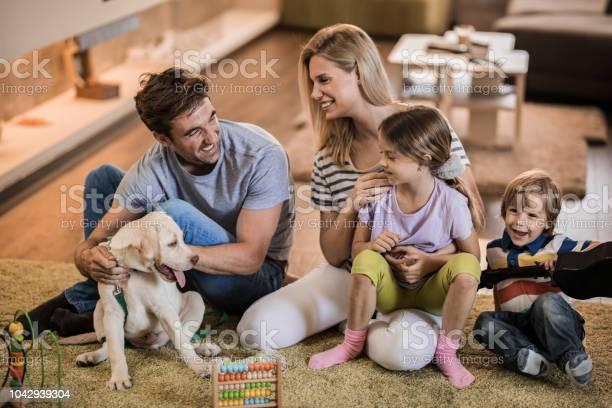 Happy parents enjoying in time with their small kids and puppy in the picture id1042939304?b=1&k=6&m=1042939304&s=612x612&h=c2gp5 frvg4ozm75t bni77ixlyychkp2g9nbyvu1yi=