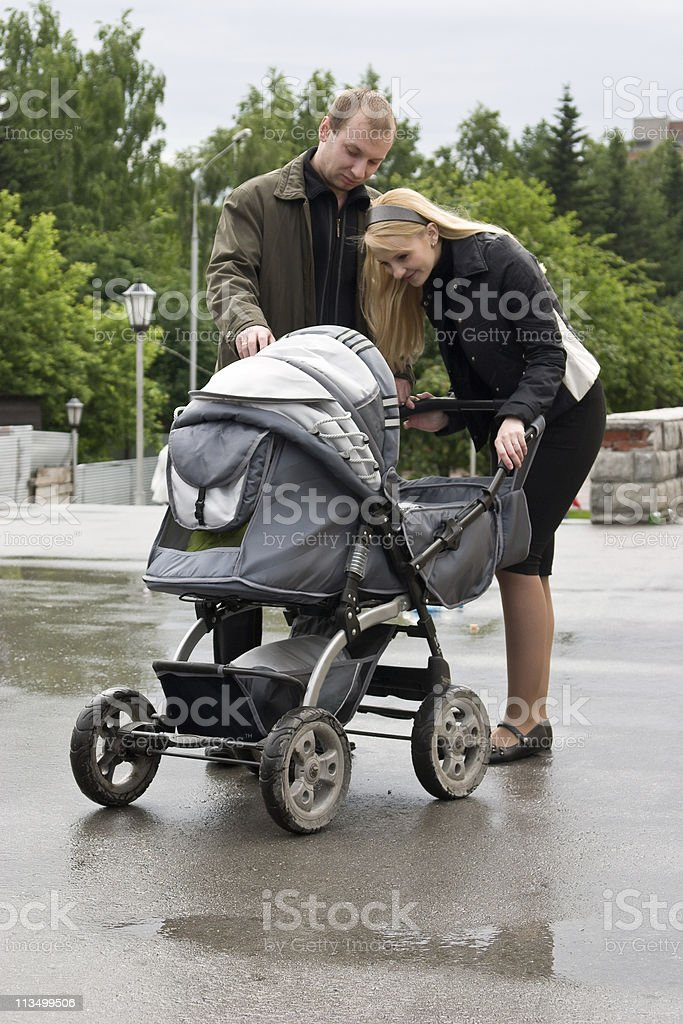 Happy parents look at the baby. stock photo