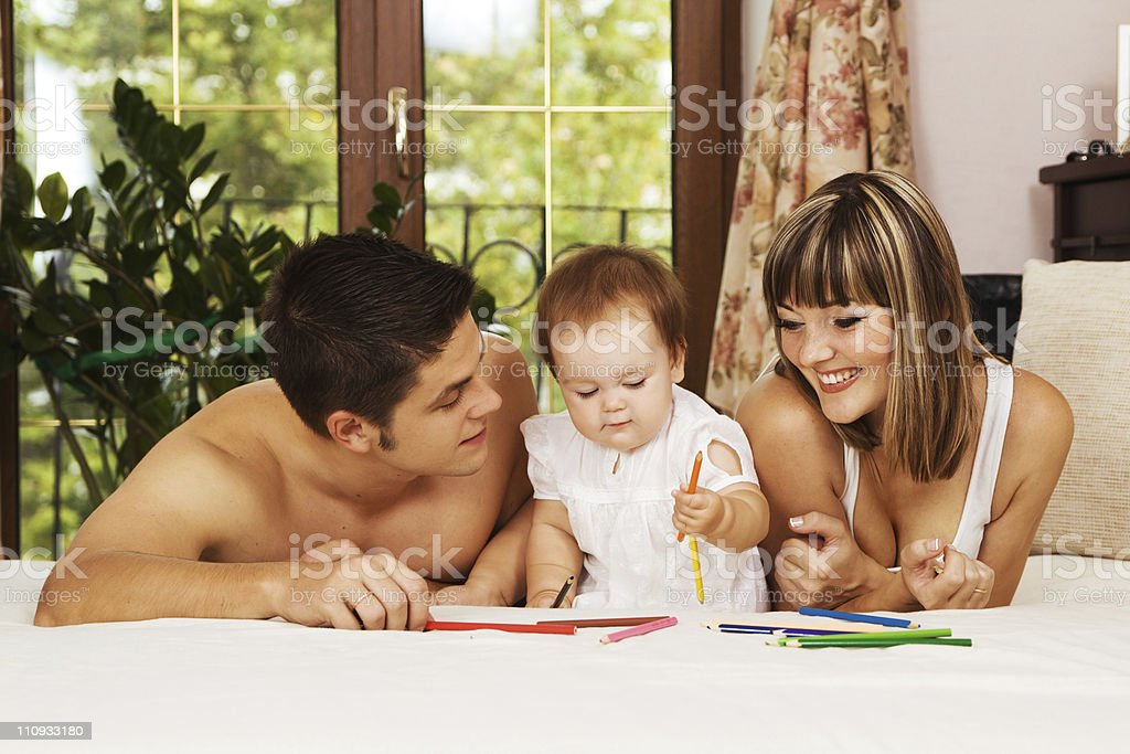 Happy parents playing with little daughter royalty-free stock photo