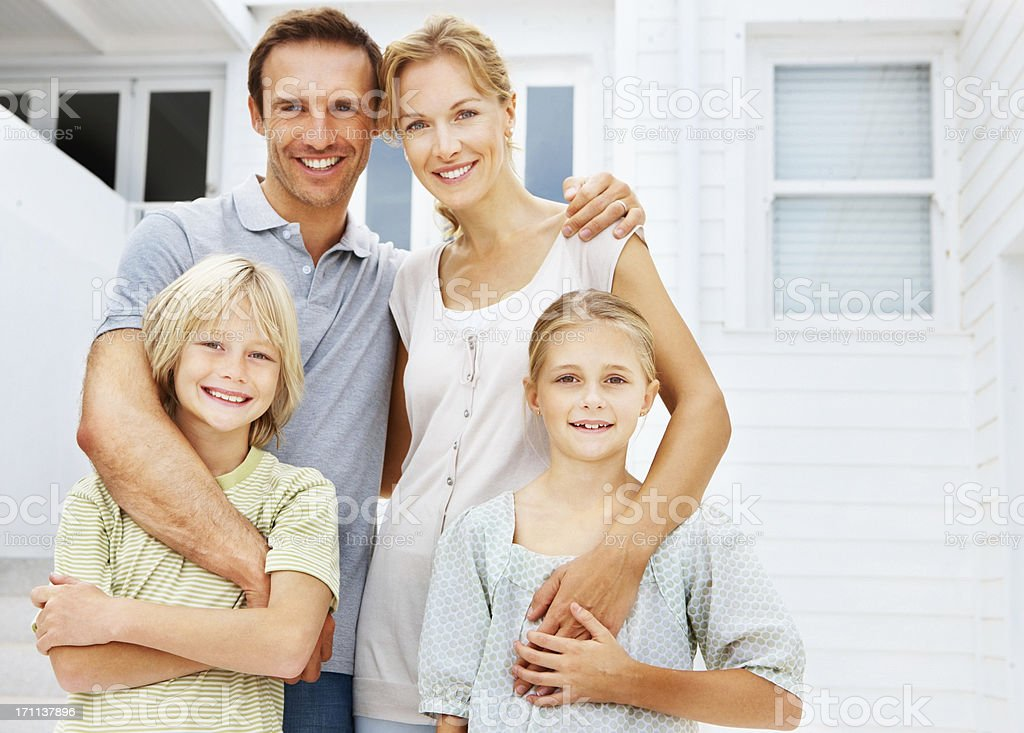 Happy parents posing with children royalty-free stock photo