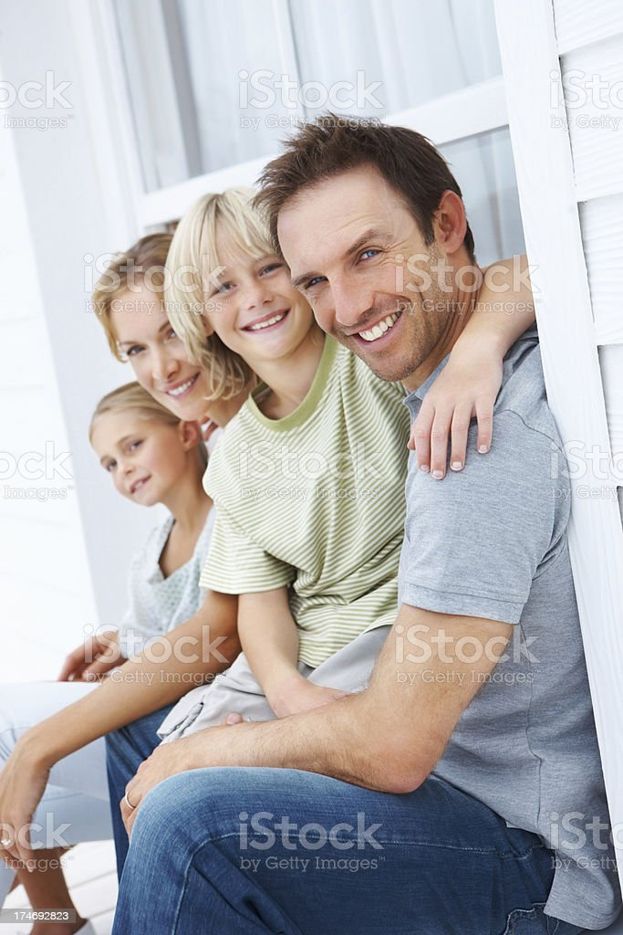 Happy parents sitting with their children royalty-free stock photo