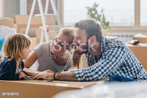 istock Happy parents talking to their son while moving into new home. 877316712