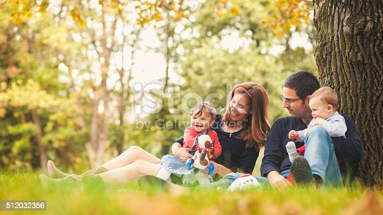 istock Happy parents with children outdoors having a good family time 512032356