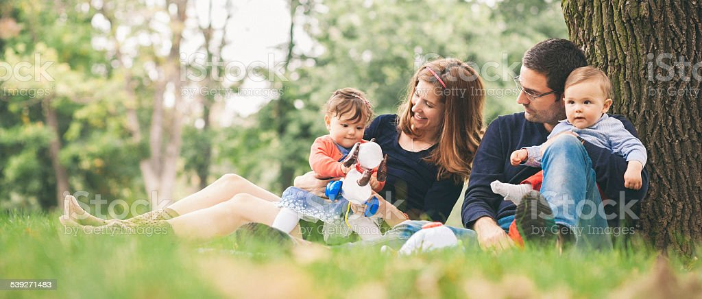 Happy parents with kids enjoying spring time in nature stock photo