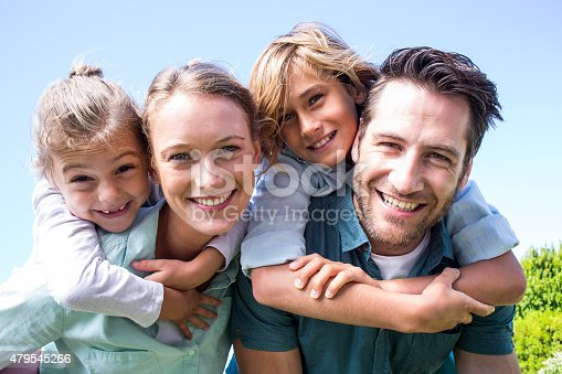 istock Happy parents with their children 479545266