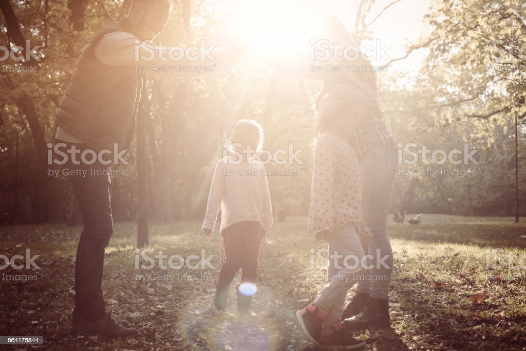 Happy parents with two child playing together in nature. royalty-free stock photo