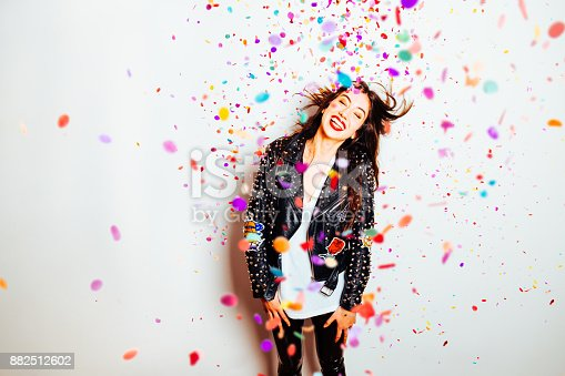 istock Happy party woman with confetti 882512602