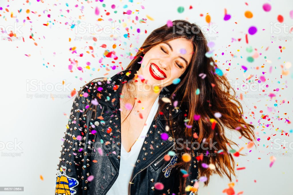 Happy party woman with confetti stock photo