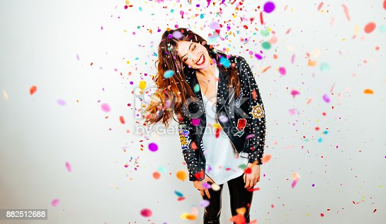 istock Happy party woman with confetti 882512688