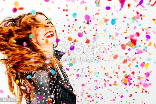 istock Happy party woman with confetti 882512756