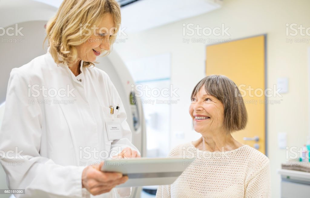 Happy patient and doctor discussing MRI scan stock photo