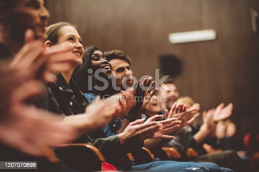 483876497 istock photo Happy people applauding in the theater 1207070899