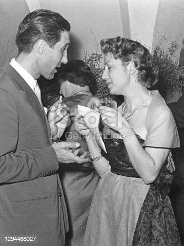 Happy people at a party in 1950.