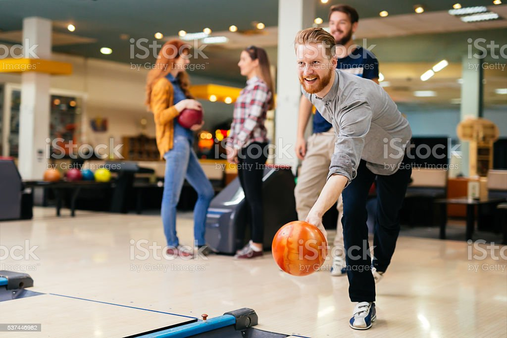 Happy people bowling stock photo