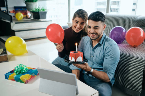 Happy People Celebrating Birthday Party Doing Video Call stock photo