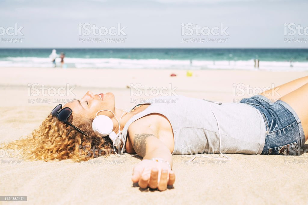 Happy people cheerful blonde beautiful curly woman lay down and relax...