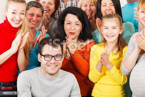 671270528istockphoto Happy people clap their hands. 486332751