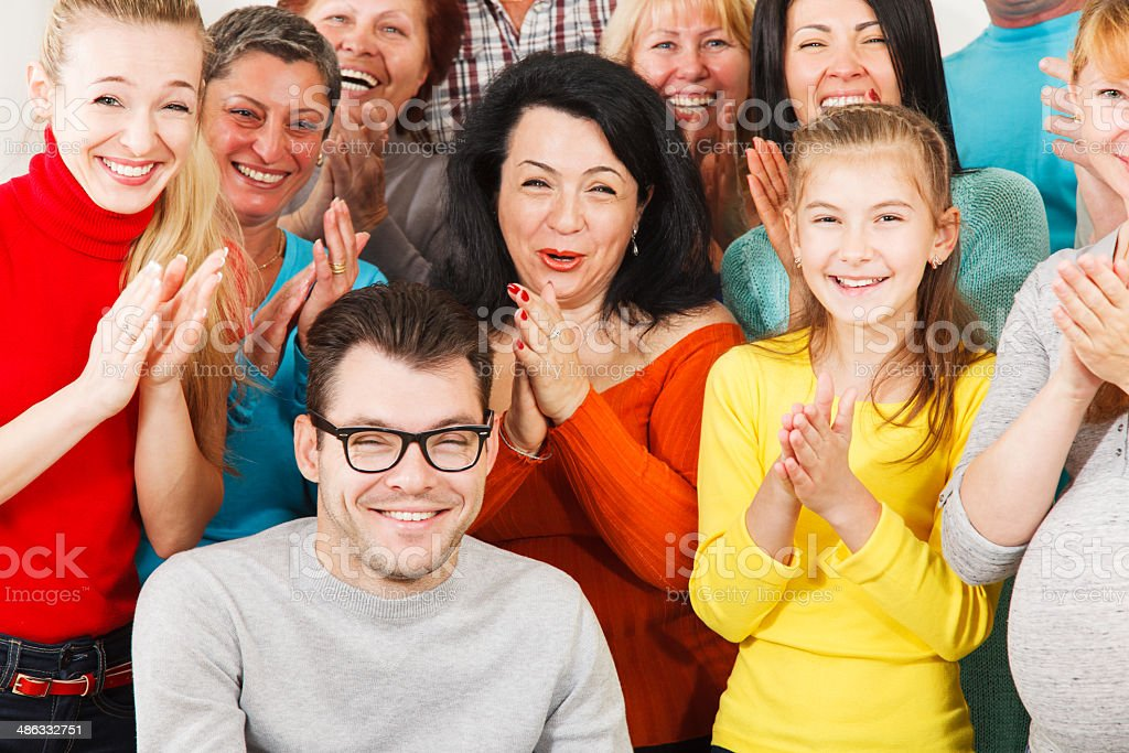 Happy people clap their hands. stock photo