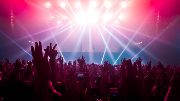 Happy People Dance in Nightclub Party Concert Happy people dance in nightclub DJ party concert and listen to electronic dancing music from DJ on the stage. Silhouette cheerful crowd celebrate New Year party 2020. People lifestyle DJ nightlife. nightclub stock pictures, royalty-free photos & images