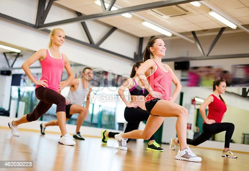 istock happy people doing lunge exercise in gym 462030223