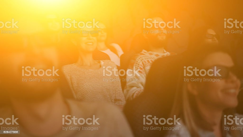 happy people enjoying in the cinema watching a 3d movie - foto de acervo