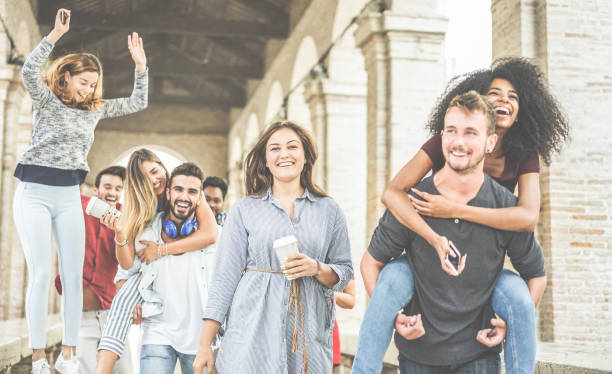 happy people having fun in city center - young people at university break enjoying time together - youth lifestyle and positive mood with friends concept - focus on center woman holding coffee cup - milan fiorentina foto e immagini stock