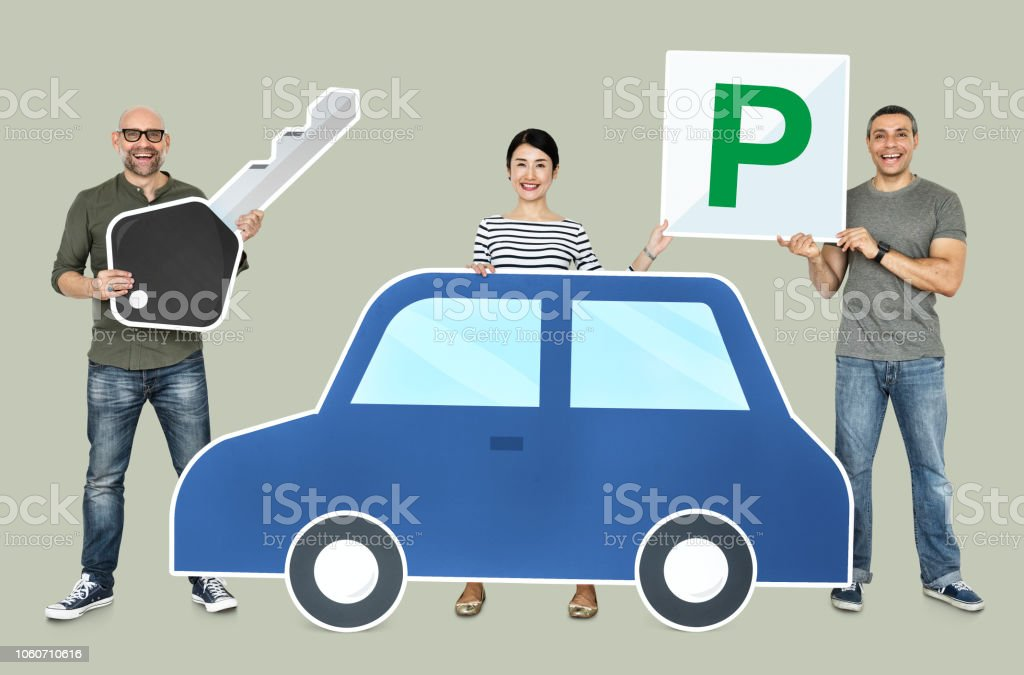 Happy people holding car icons stock photo