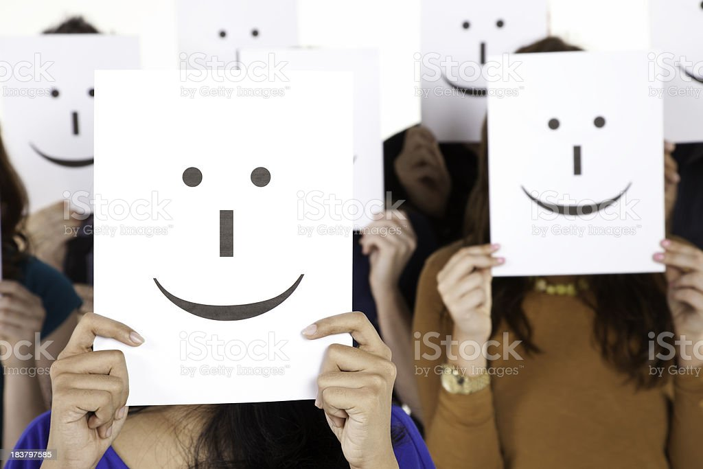 Happy People Holding Smiling Face Signs royalty-free stock photo