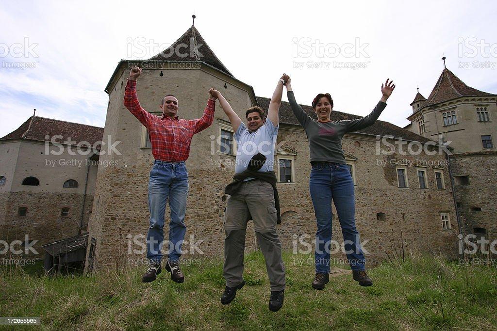Happy People Jump at Fagaras Castle Transylvania Romania royalty-free stock photo