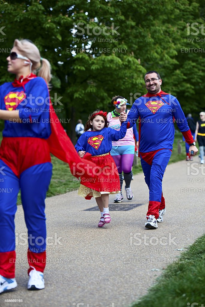 Happy people on charity fun run dressed as super heroes royalty-free stock photo
