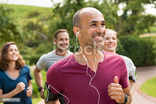 istock Happy people running 658600202