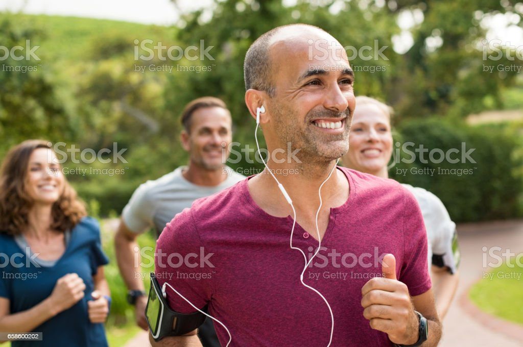 Happy people running stock photo