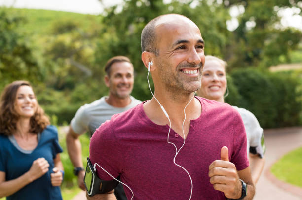 happy people running - mid adult stock pictures, royalty-free photos & images