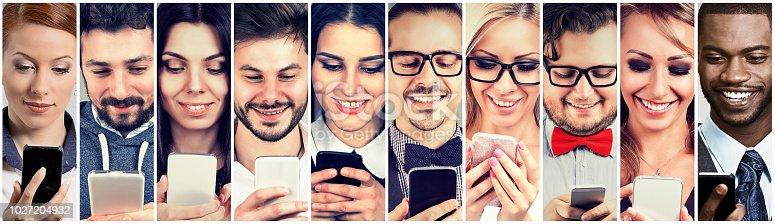 istock Happy people using mobile smart phone 1027204932