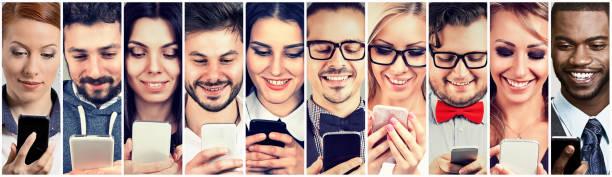Happy people using mobile smart phone stock photo