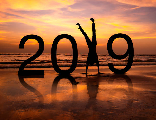 Happy person silhouette in New Year 2019 stock photo