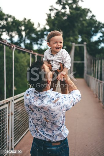 istock Happy photo father and child having fun outdoors 1010300190