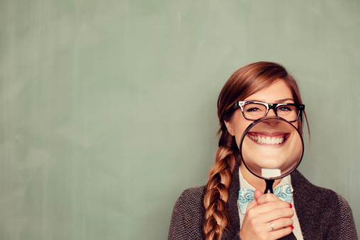 A geeky female college student is all smiles about school.