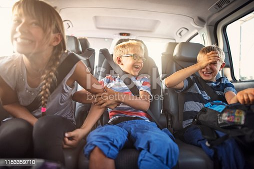 istock Happy playful kids travelling by car 1153359710