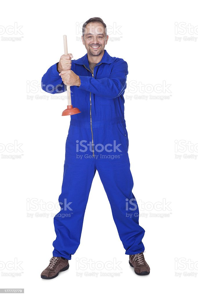 Happy Plumber Holding Plunger stock photo