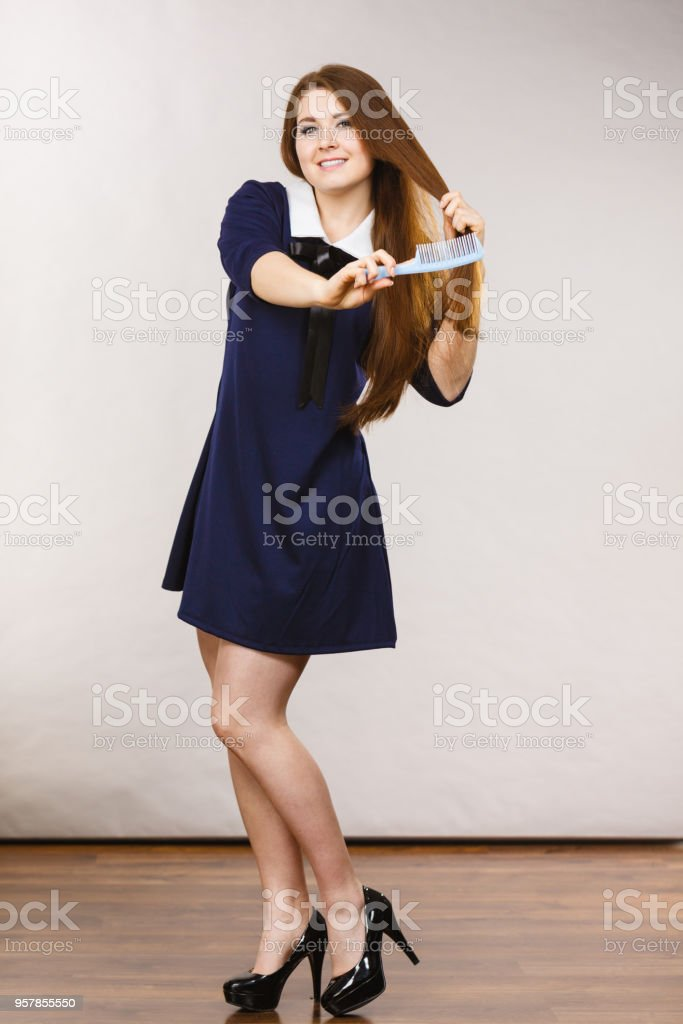Happy positive woman with long brown hair stock photo