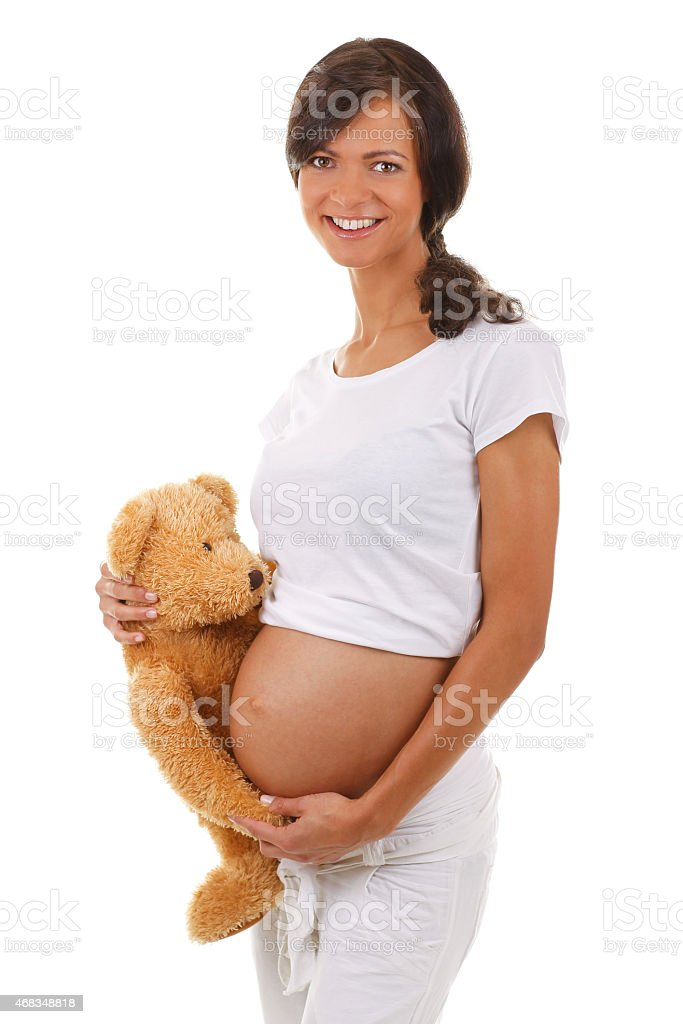 Happy pregant woman with her teddy bear royalty-free stock photo