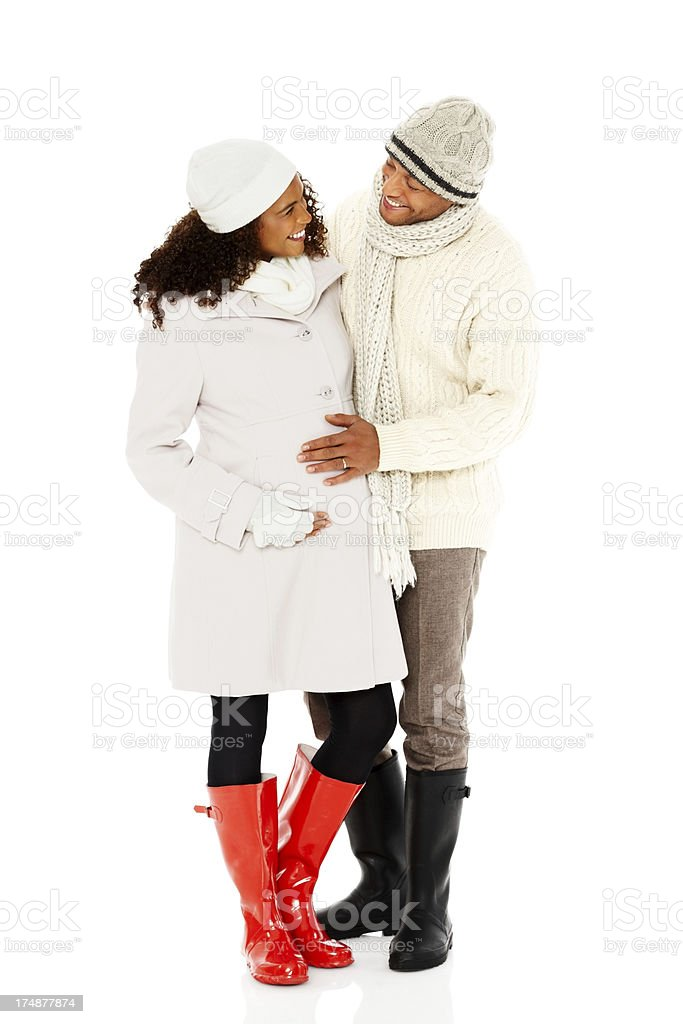 Happy pregnant couple in winter wear royalty-free stock photo