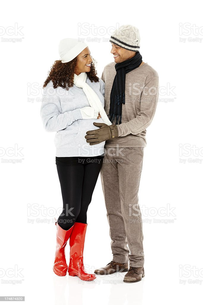 Happy pregnant couple standing together on white royalty-free stock photo