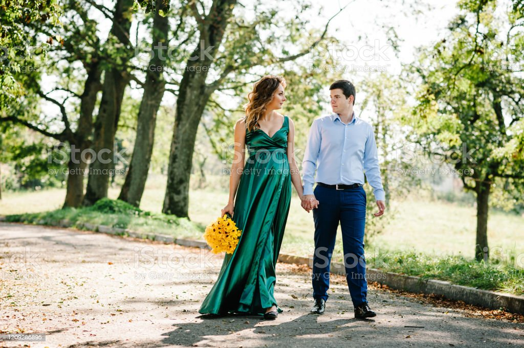 Happy Pregnant Couple Walking In Nature Romantic Moments Pregnancy In Park Stock Photo Download Image Now Istock
