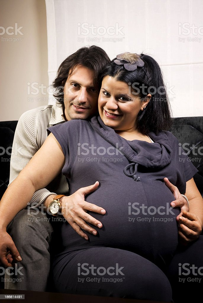 Happy pregnant wife and husband at home royalty-free stock photo